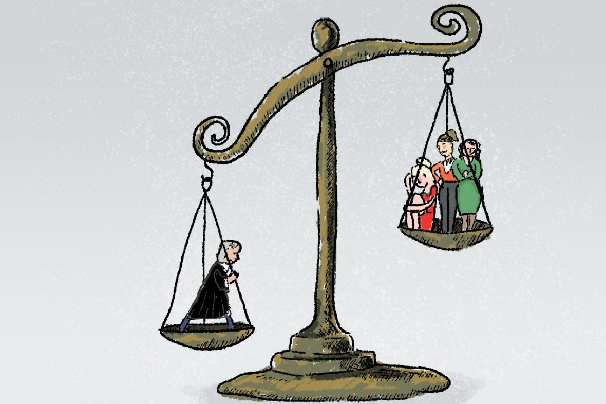 Judge and women on judicial scales, with judge's side weighing down.