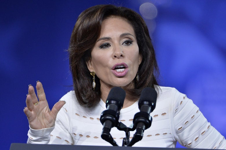 Jeanine Pirro speaks from behind a podium.