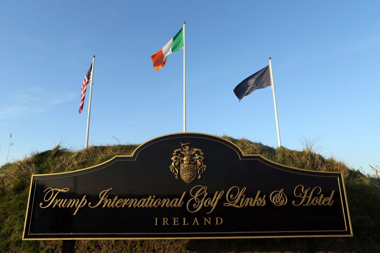 Flags fly outside the entrance to Trump International Golf Course, owned by US President-elect Donald Trump, near Doonbeg, on the west coast of Ireland, on December 2, 2016.
