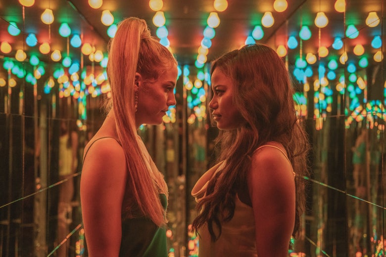 two women face off in a hall of mirrors