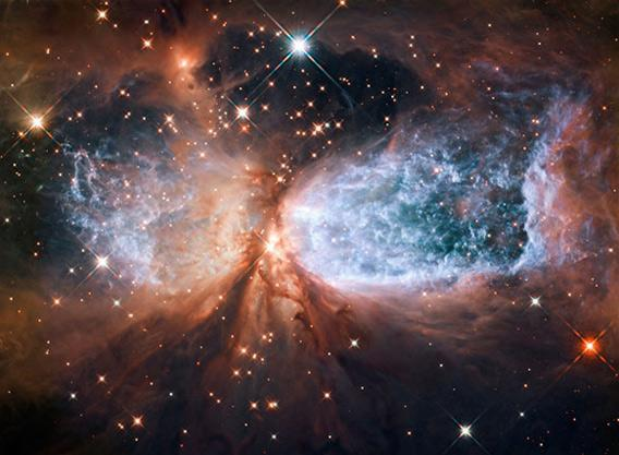 Hubble image of the massive young star Sharpless 2-106.