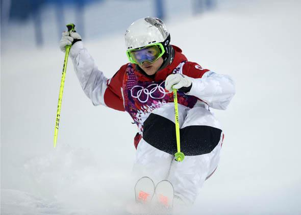 Canada's Maxime Dufour-Lapointe competes in the Women's Freestyle Skiing Moguls qualifications at the Rosa Khutor Extreme Park during the Sochi Winter Olympics on February 6, 2014.