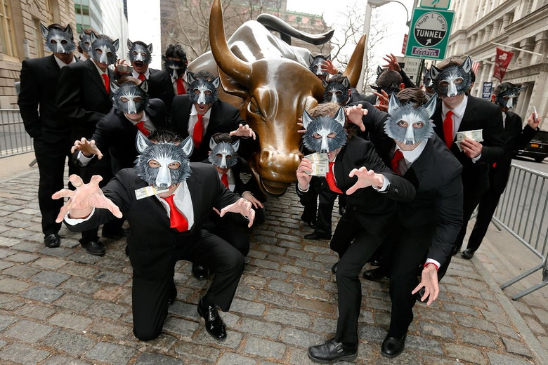 A bunch of people in wolf masks in front of the Wall Street bull statue.