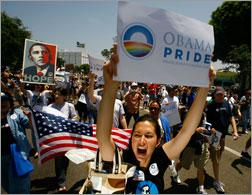 Gay pride participants hold signs in support of Democratic presidential hopeful Barack Obama (D-IL)