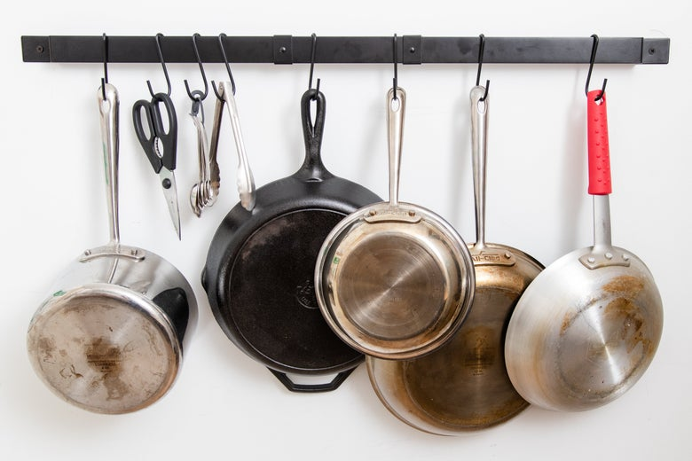 Range Kleen's expandable pot rack with pots hanging.