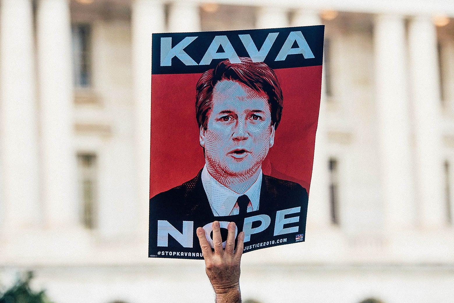 """A protester holds a sign that says """"KAVA NOPE"""" at a rally near Capitol Hill on Sept. 4"""