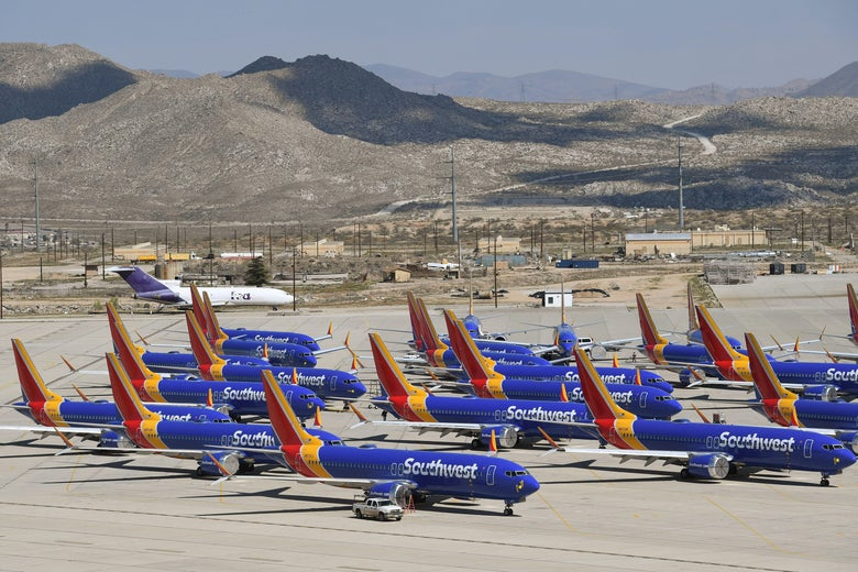 A number of Southwest Airlines Boeing 737 MAX aircraft are parked on the tarmac.