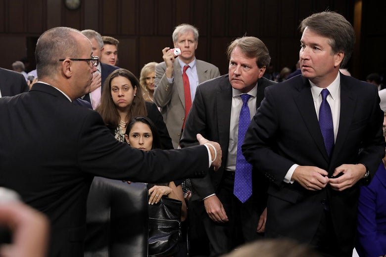 Fred Guttenberg extends his hand to Supreme Court nominee Brett Kavanaugh, who looks concerned.