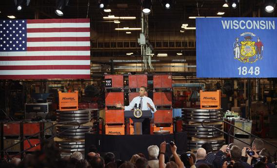 Barack Obama speaks to workers at a factory