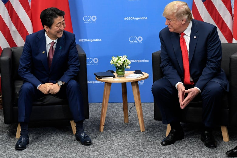 President Donald Trump speaks with Japan's Prime Minister Shinzo Abe in the sidelines of the G20 Leaders' Summit in Buenos Aires, on November 30, 2018.