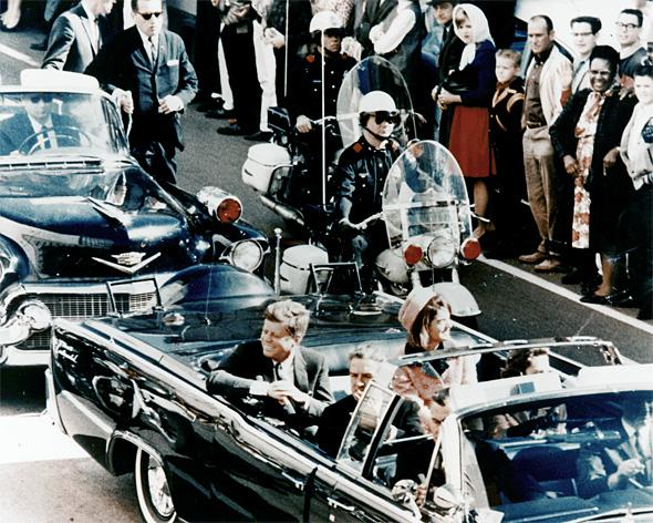 Picture of President Kennedy in the limousine in Dallas, Texas, on Main Street, minutes before the assassination.