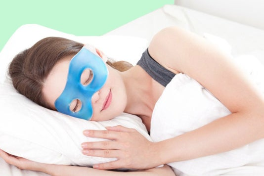 Woman wearing a Plemo Spa Eye Mask while sleeping.