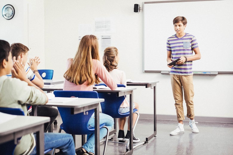 A student gives a presentation in front of class.