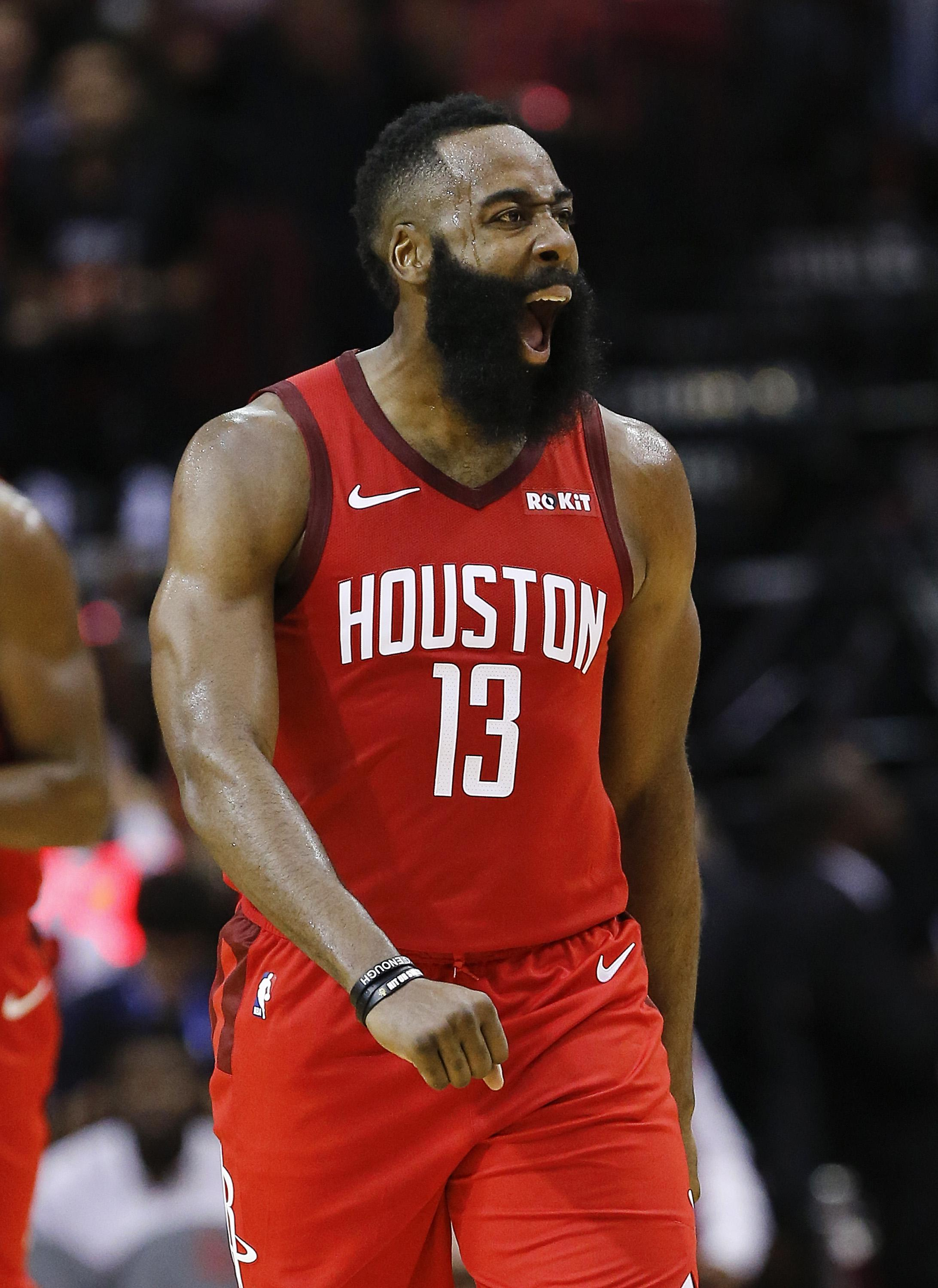 HOUSTON, TEXAS - DECEMBER 25: James Harden #13 of the Houston Rockets reacts after making a three point basket during the fourth quarter against the Oklahoma City Thunder at Toyota Center on December 25, 2018 in Houston, Texas. NOTE TO USER: User expressly acknowledges and agrees that, by downloading and or using this photograph, User is consenting to the terms and conditions of the Getty Images License Agreement. (Photo by Bob Levey/Getty Images)