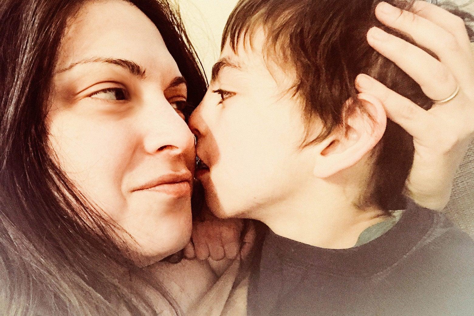 Elizabeth Picciuto holding her son.