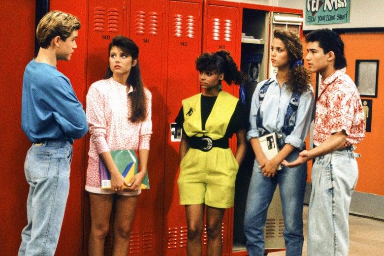 A still of Mark-Paul Gosselaar, Mario Lopez, Lark Voorhies, Tiffani Thiessen, and Elizabeth Berkley as Zack, A.C., Lisa, Kelly, and Jessie in Saved by the Bell.