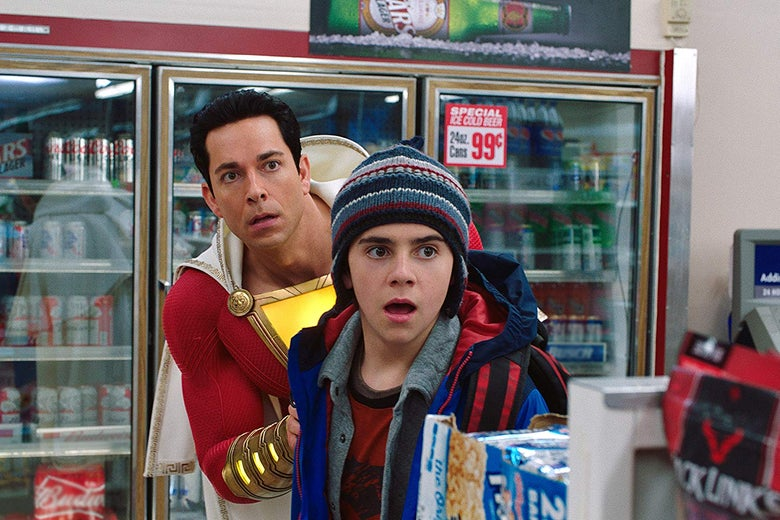 Zachary Levi, wearing a red, caped superhero suit, and Jack Dylan Grazer in a convenience store.
