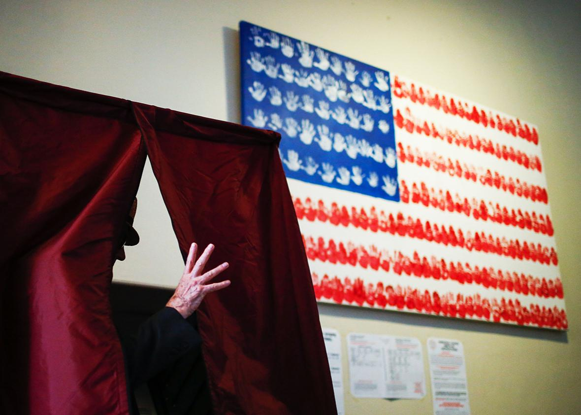 A man casts his ballot at polling station during New Jersey's primary elections on June 7, 2016 in Hoboken, New Jersey.