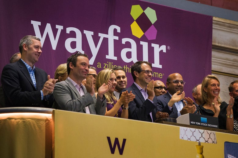 From center, Wayfair co-chairmen and co-founders Steve Conine and Niraj Shah ring the opening bell of the New York Stock Exchange on Oct. 2, 2014.