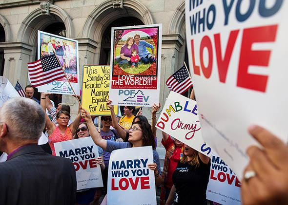 Same-sex marriage supporters hold a rally in front of the 4th U.S. Circuit Court of Appeals before a court hearing May 13, 2014 in Richmond, Virginia.