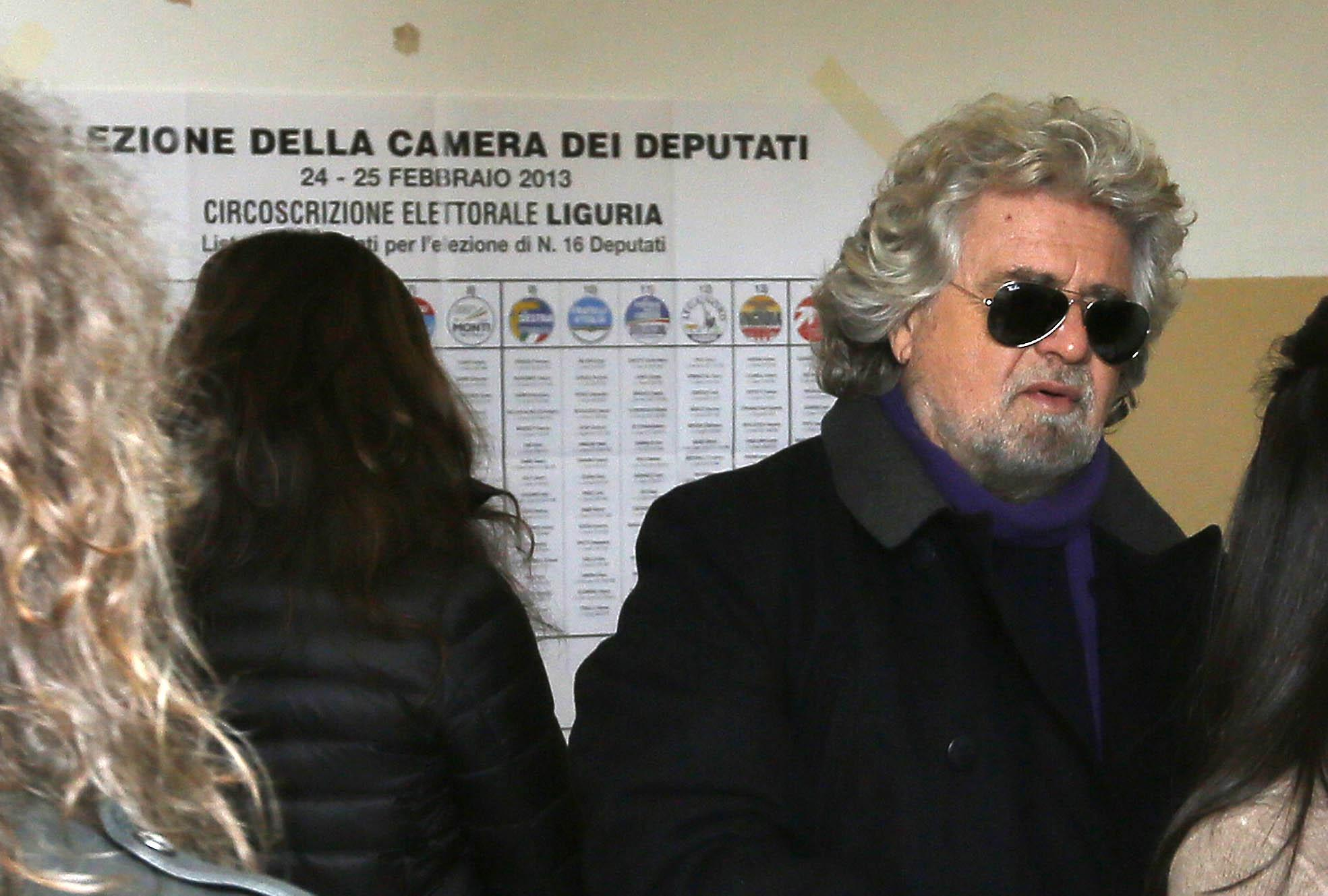 Five Stars movement's leader and former comedian Beppe Grillo arrives to vote at a polling station in St. Ilario near Genova on Feb. 25, 2013.
