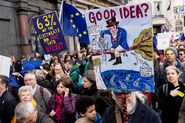 People hold up signs and European flags as they attend a march and rally organized by the pro-European People's Vote campaign for a second EU referendum in central London on March 23, 2019.