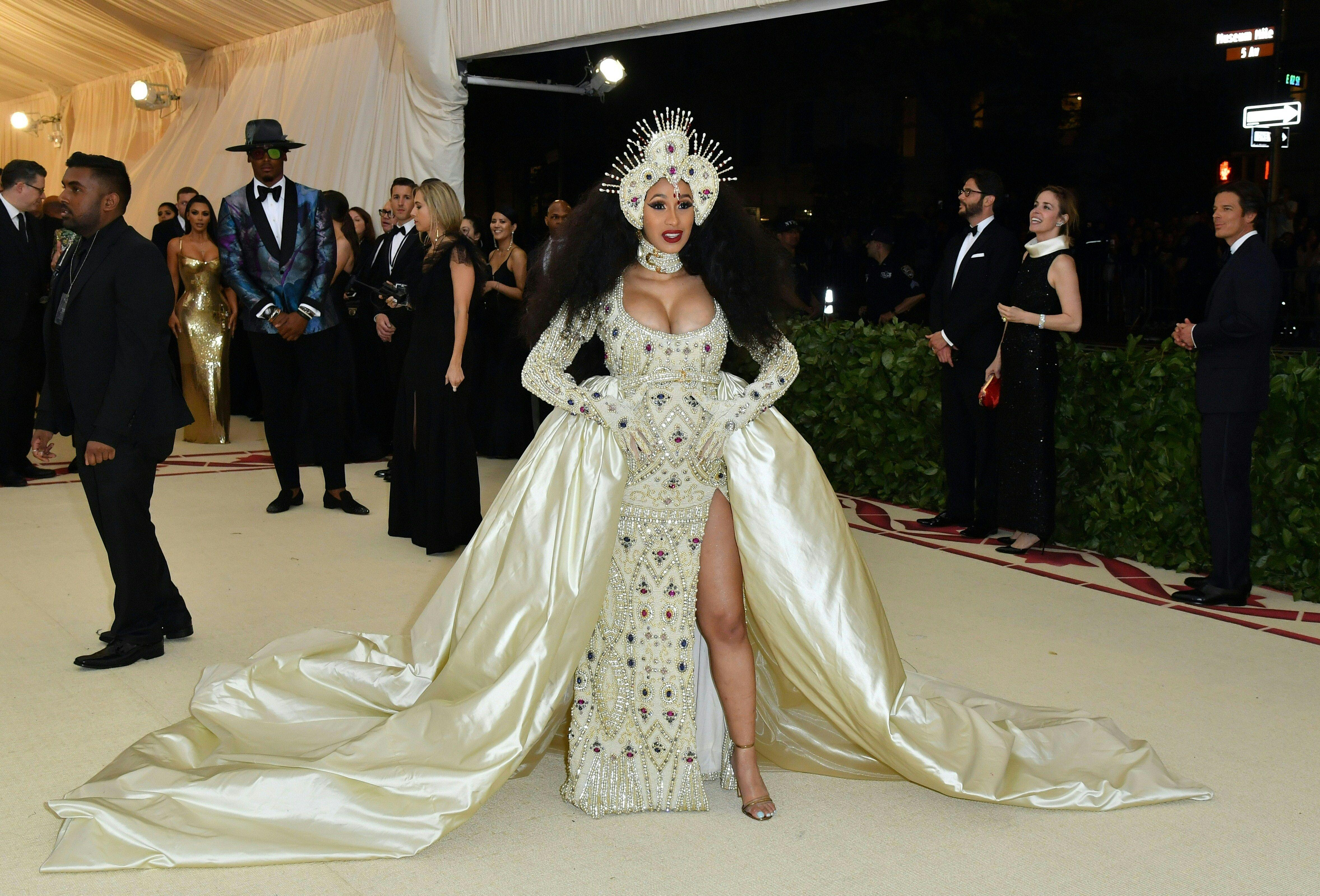 Cardi B arrives for the 2018 Met Gala on May 7, 2018, at the Metropolitan Museum of Art in New York. - The Gala raises money for the Metropolitan Museum of Arts Costume Institute. The Gala's 2018 theme is Heavenly Bodies: Fashion and the Catholic Imagination. (Photo by Angela WEISS / AFP)        (Photo credit should read ANGELA WEISS/AFP/Getty Images)