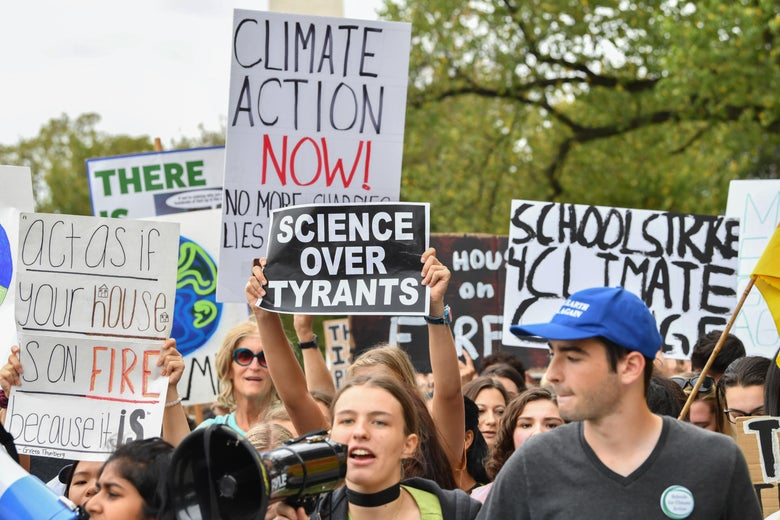 Teenagers and students take part in a climate protest outside the White House.