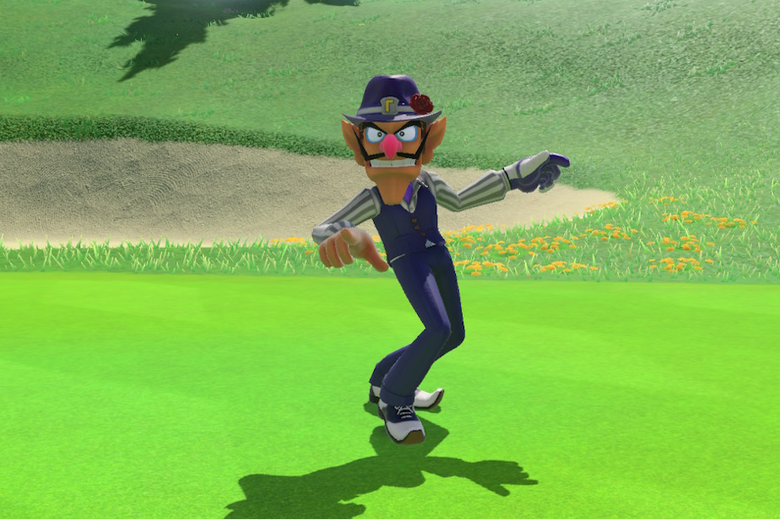 A thin man in purple stands in the middle of a golf course.