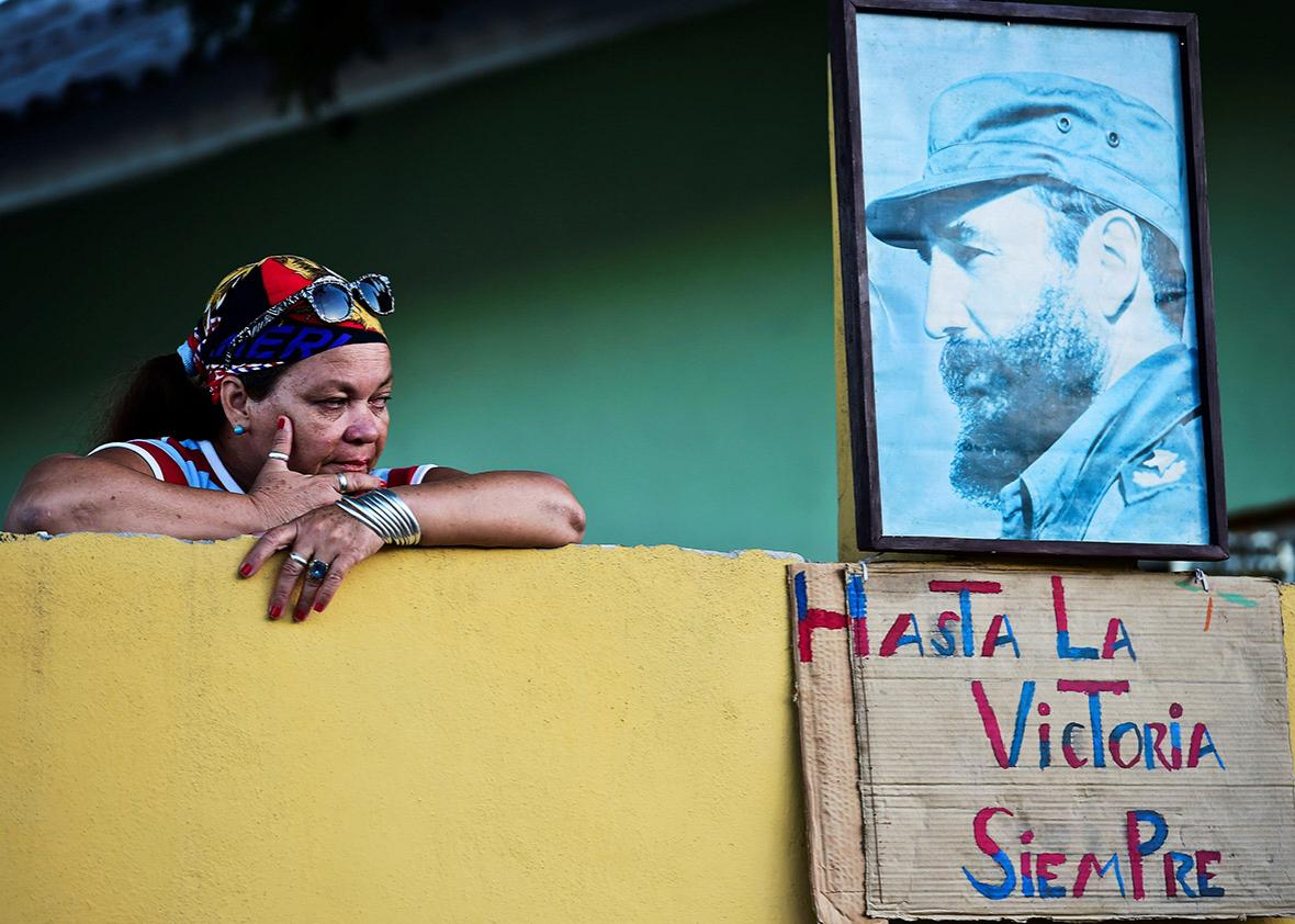 Cubans wait for the passage of the urn with the ashes of Cuban leader Fidel Castro on its way to the cemetery, near Revolution Square in Santiago, Cuba on December 4, 2016 .