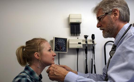 Dr. Jim Spears examines Sarah Ittner, a New York-based actor who does not have health coverage, at the Actors Fund's Al Hirschfeld Free Health Clinic on March 23, 2011 in New York City.