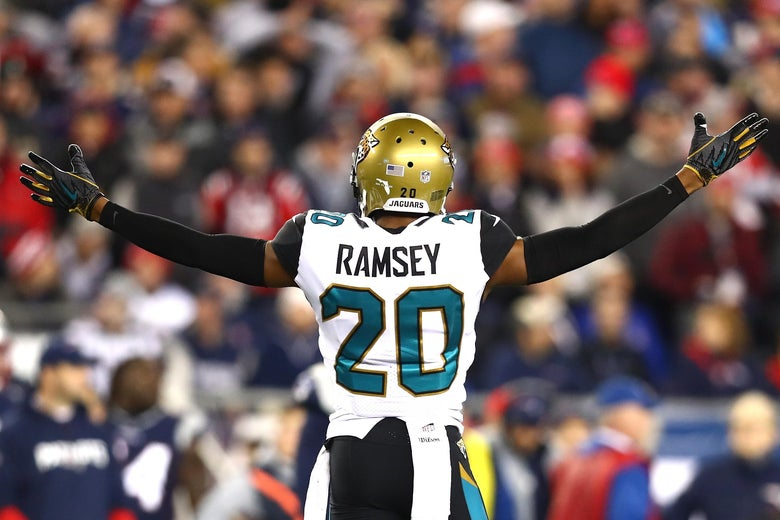 Jalen Ramsey of the Jacksonville Jaguars lifts his arms up, wide, during the AFC Championship Game against the New England Patriots on Jan. 21 in Foxborough, Massachusetts.