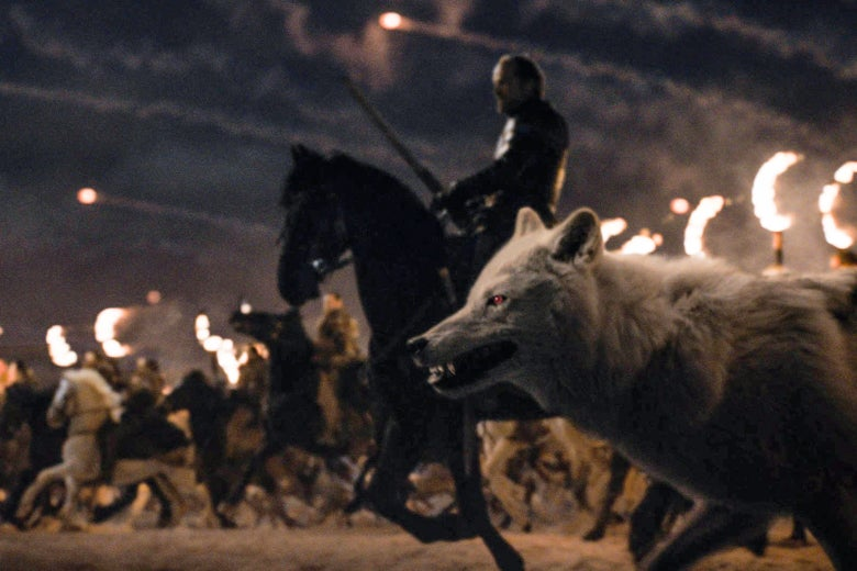 Jorah Mormont and Ghost ride into battle.
