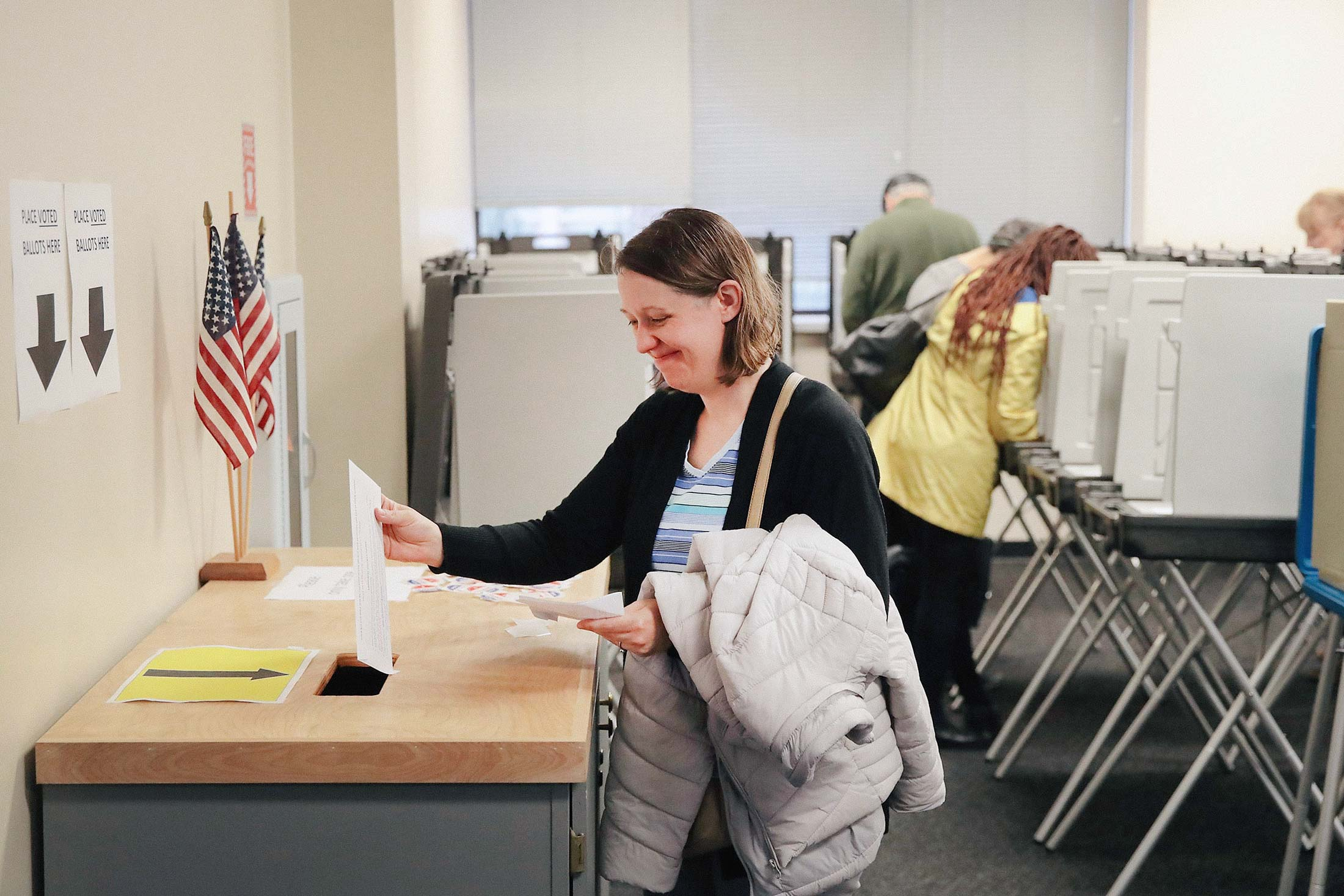 Voters cast ballots for the midterm elections at the Polk County Election Office