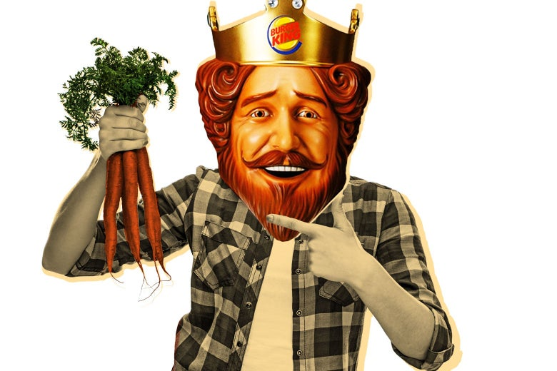 The Burger King king holding a bunch of carrots.
