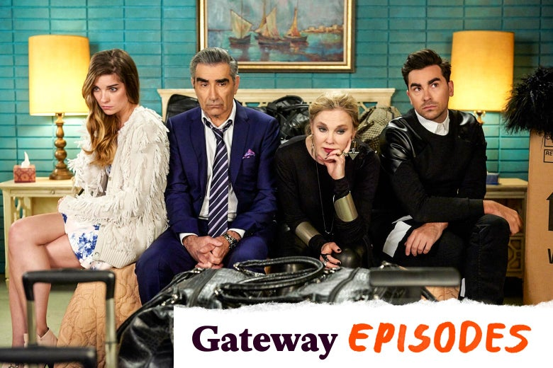 Annie Murphy, Eugene Levy, Catherine O'Hara, and Dan Levy sit on a motel bed in this still from Schitt's Creek.