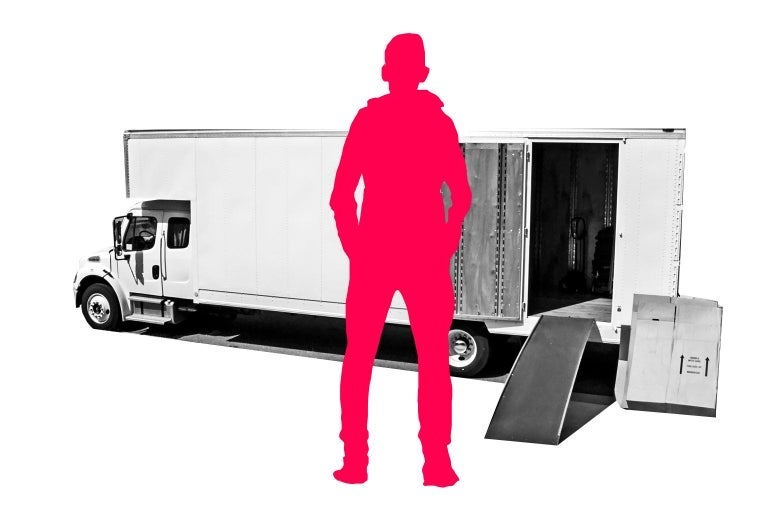 Silhouette of a man standing in front of a moving truck.