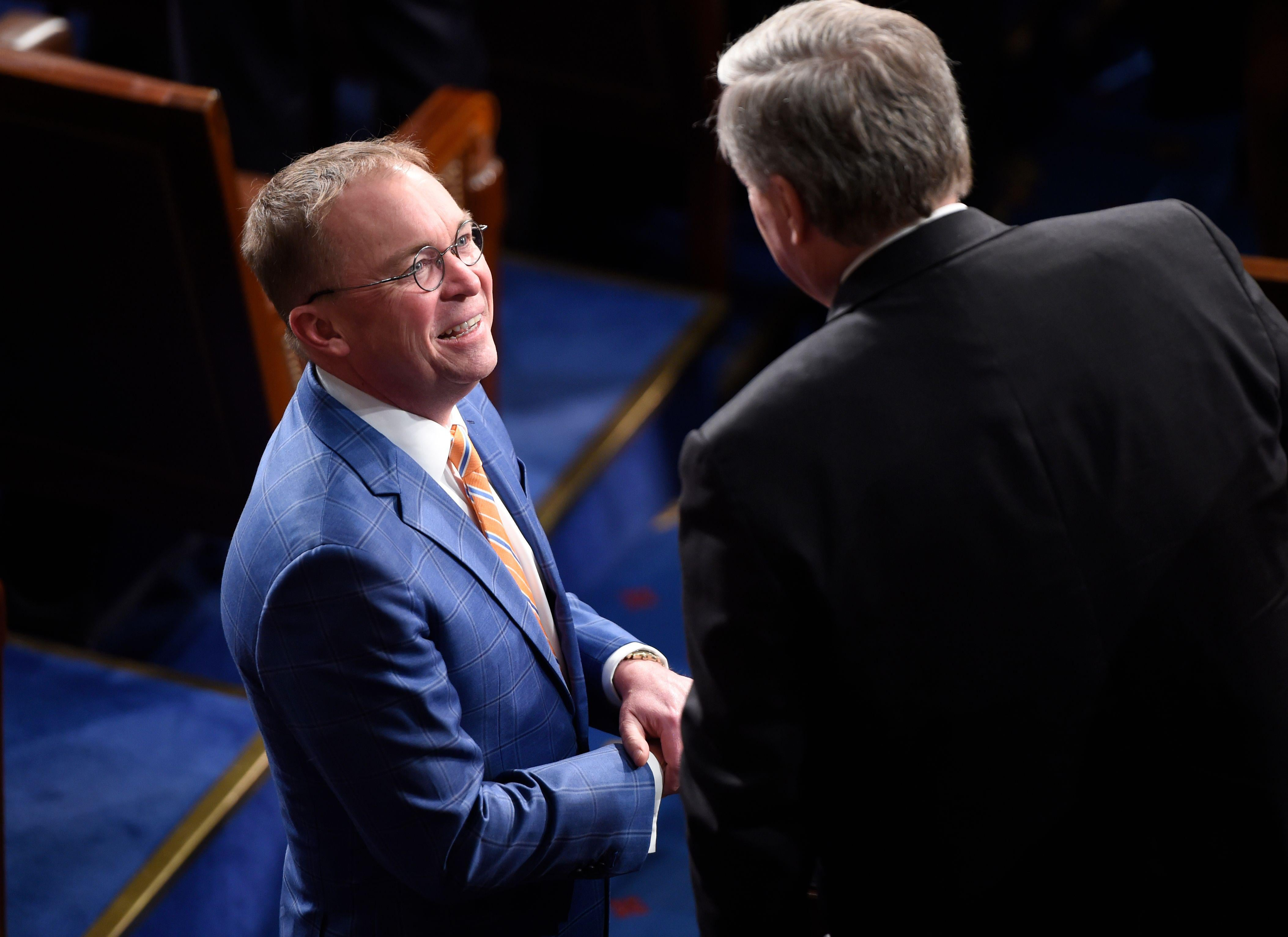 Mulvaney smiling in the House chamber.