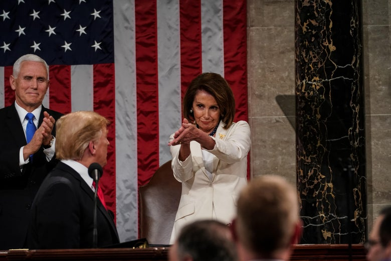 Speaker Nancy Pelosi claps at President Trump during the State of the Union.