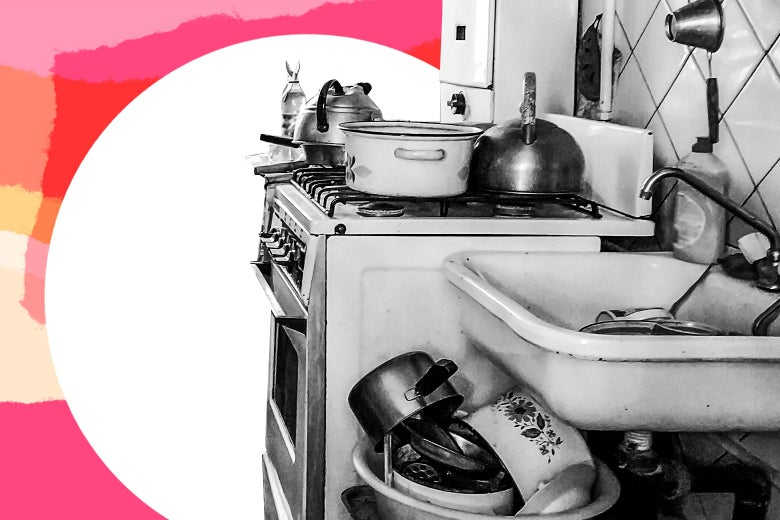 A messy kitchen with pots and pans everywhere.