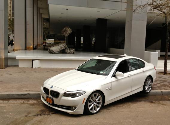 BMW on sidewalk