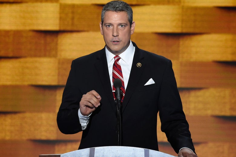 Rep. Tim Ryan speaking at a podium.
