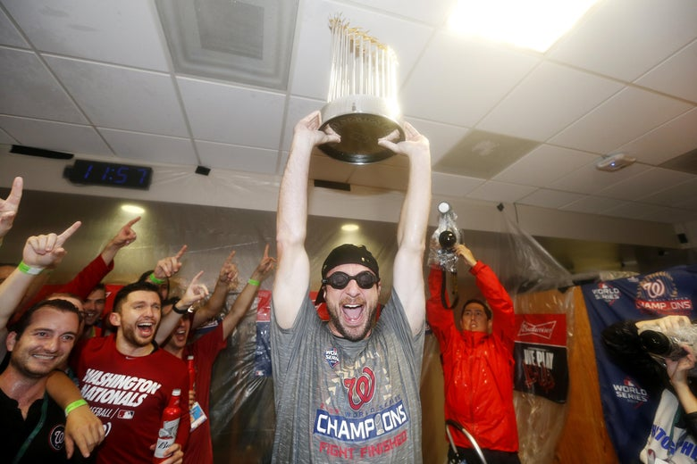 Max Scherzer of the Washington Nationals celebrates in the locker room after Game 7 of the 2019 World Series.