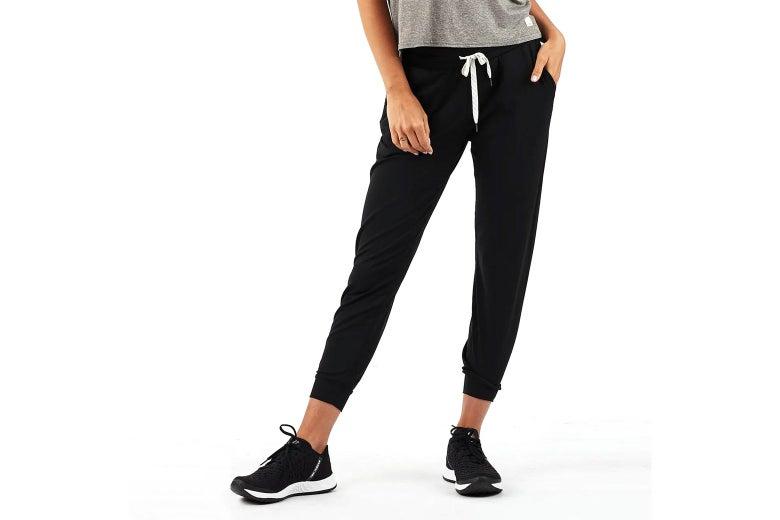 Lower body of model wearing black joggers