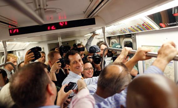 Former U.S. Congressman and New York City mayoral candidate Anthony Weiner rides the subway between campaign events in New York, May 23, 2013.