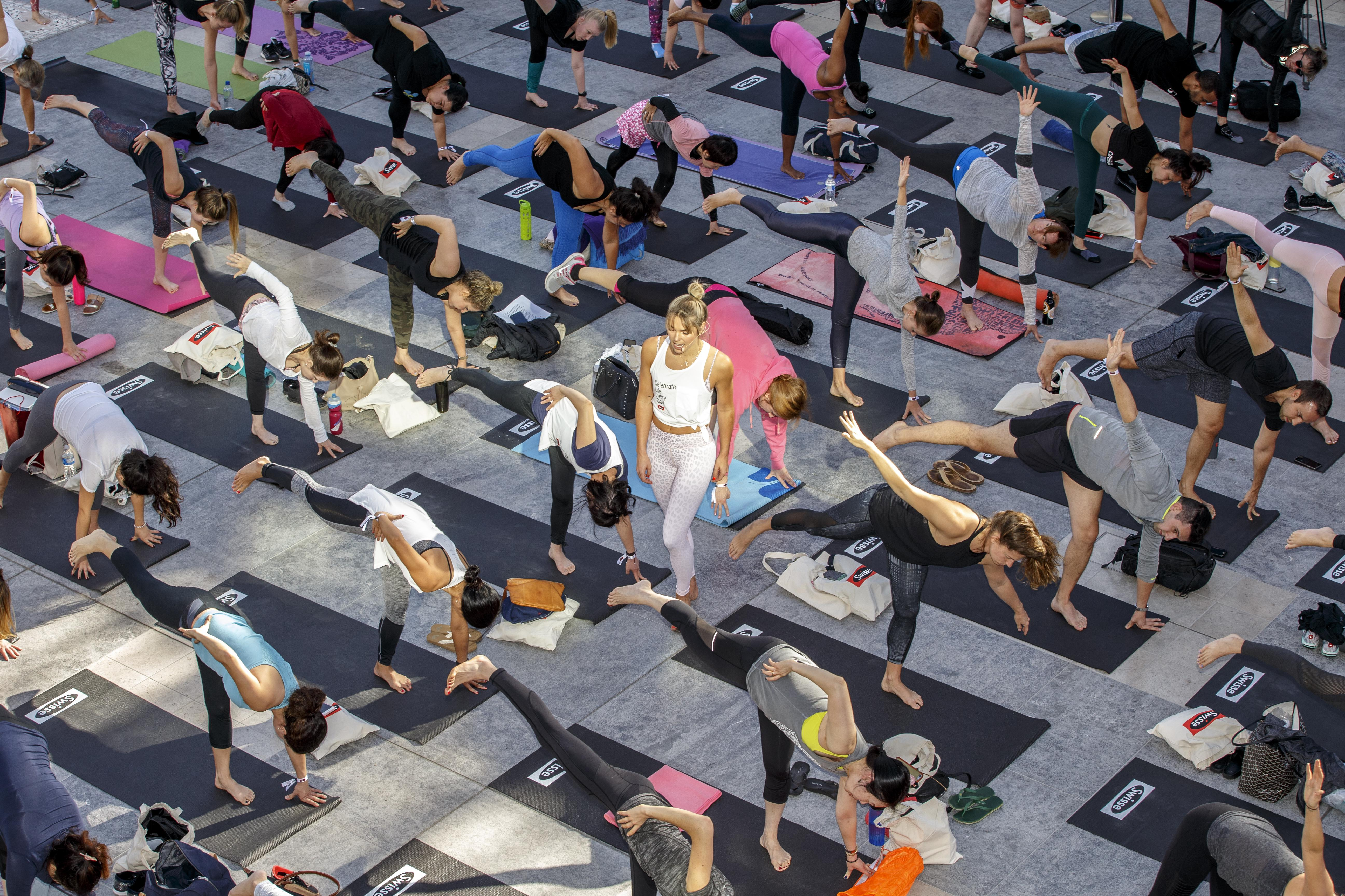 Guests #CelebrateLifeEveryDay at the Swisse Wellness yoga event lead by brand ambassador Ashley Hart (C) at A Mindful Morning with Swisse Wellness & G'Day USA at Westfield Century City on January 14, 2018 in Century City, California.