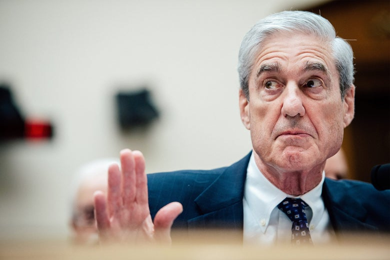 Mueller raising his hand as if in rebuttal.