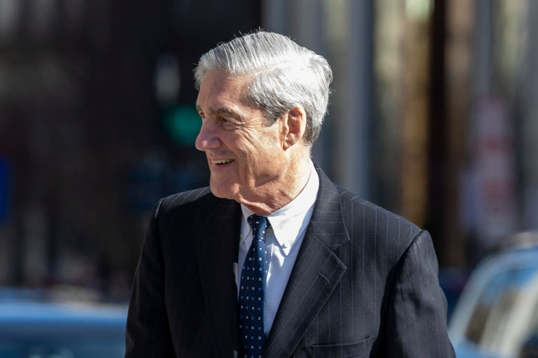 Mueller, wearing a suit, looks to his right in a photo taken outdoors.