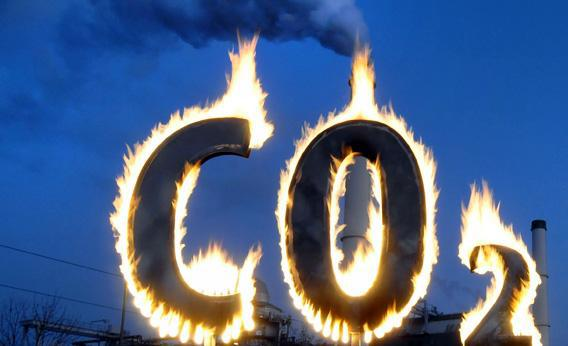 Greenpeace activists burn a symbol of carbon dioxide as they demonstrate in 2008 in front of the Klingenberg power plant in Berlin.