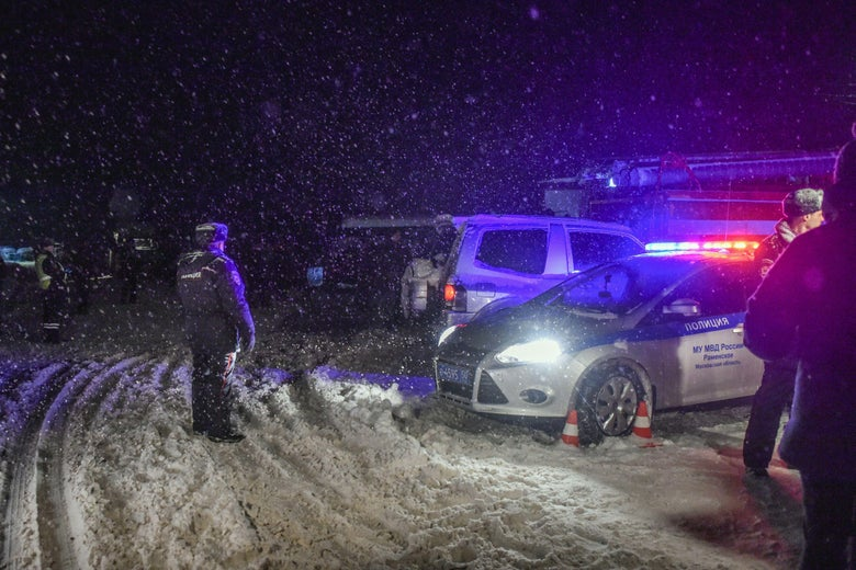 Police block the road near the site of air crash outside Moscow on February 11, 2018.A Russian passenger plane carrying 71 people crashed outside Moscow on February 11 after taking off from the capital's Domodedovo airport. /